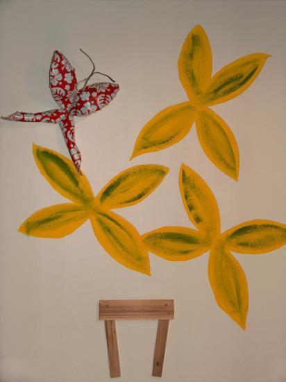 Pot de fleurs et papillon